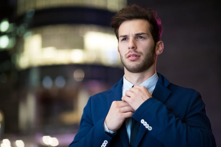 Business Casual Man Adjusting Tie