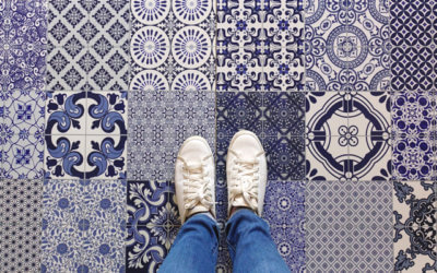 Selfie of feet with sneaker shoes on art pattern tiles floor bac