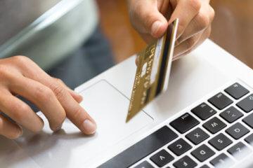 Woman shopping laptop credit card