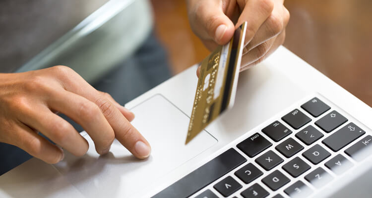 Woman shopping laptop credit card