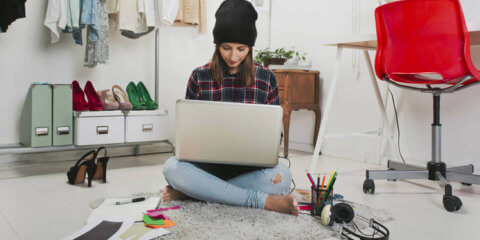 fashion blogger sitting floor