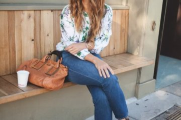fashion blogger sitting jeans