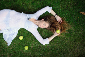 girl grass apples