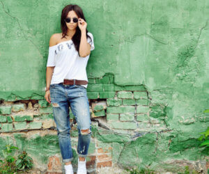 girl green wall sunglasses