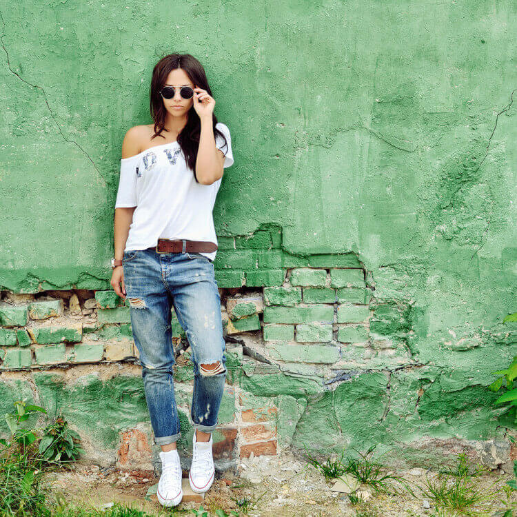 girl green wall sunglasses