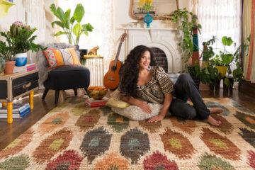 girl sitting carpet