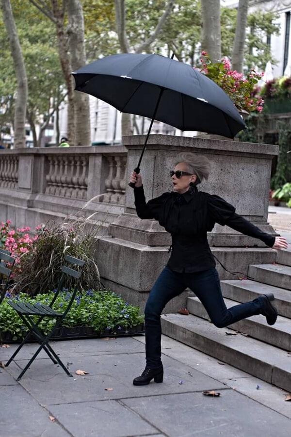 lyn slater holding umbrella