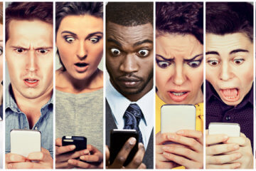 men and women looking shocked at mobile phone