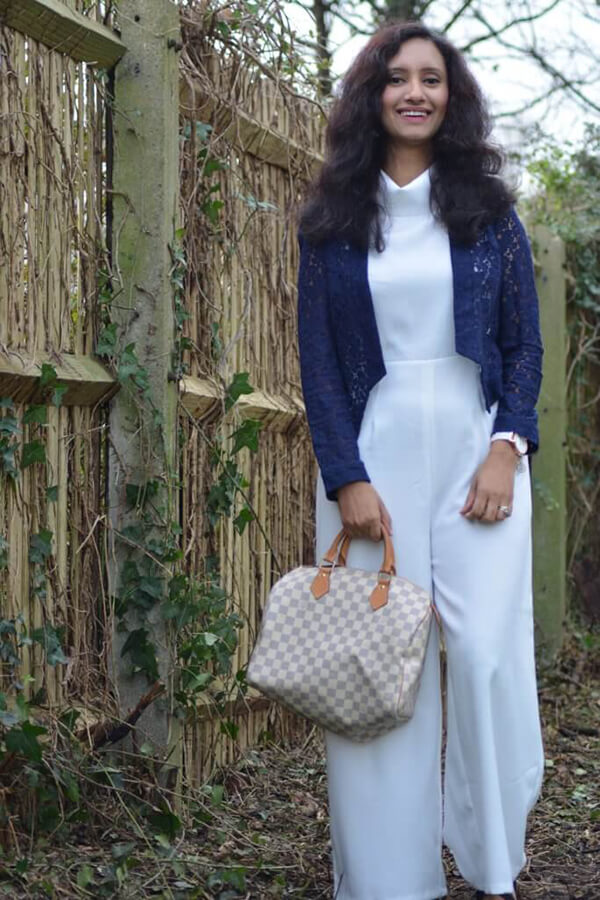 natasha kundi bag white dress standing