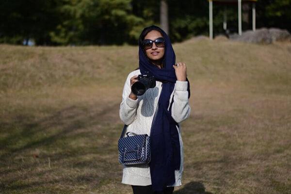 natasha kundi holding camera
