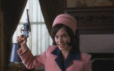 parker posey holding gun