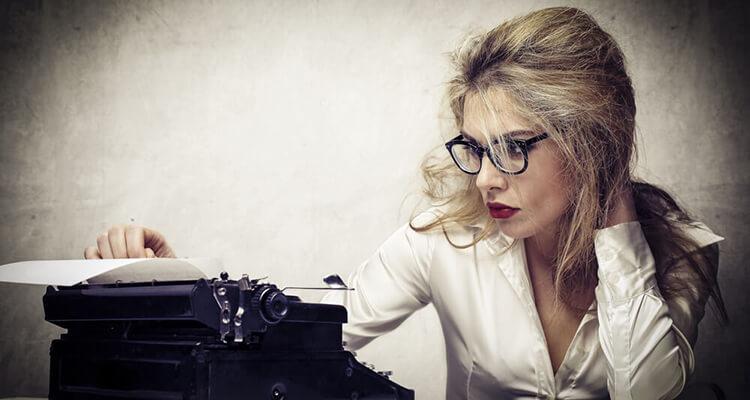 woman operating typewriter